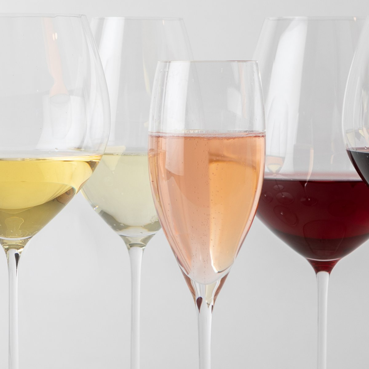 Four Diff Wine Glass Types with Wine