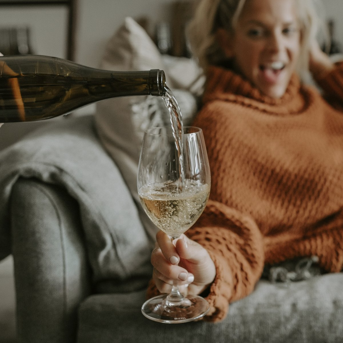 Woman on Couch Wine in Glass