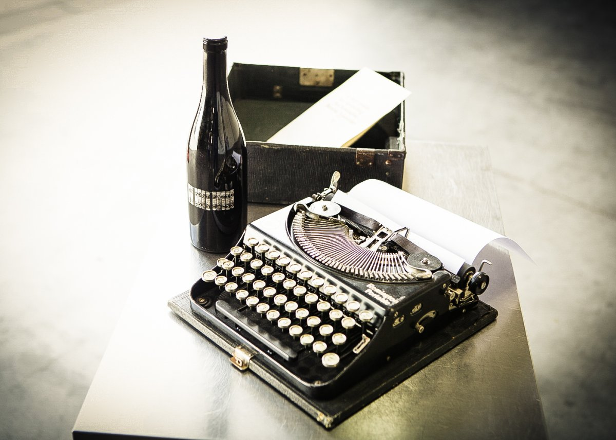 wine bottle with a old typewriter