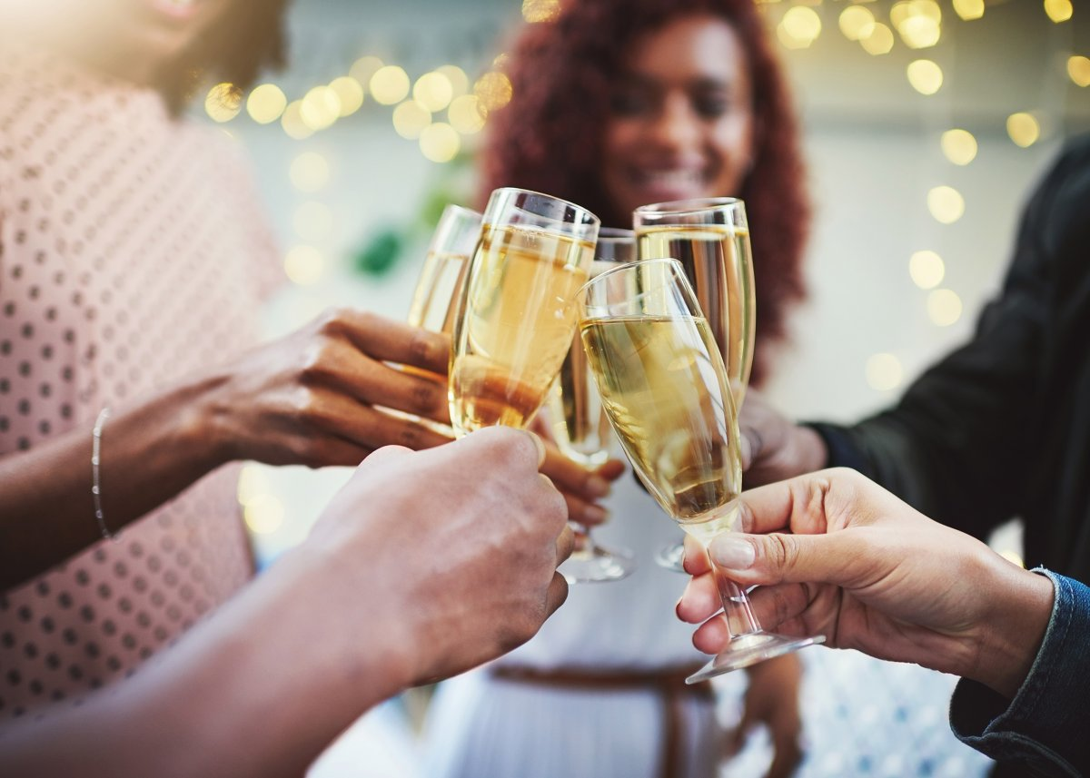 People cheering with champagne glasses
